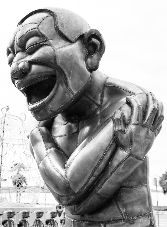 Detail of the sculpture A-maze-ing Laughter by Yue Minjun, in Vancouver, British Columbia