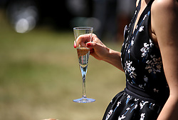 Racegoers enjoy a drink during day four of Royal Ascot at Ascot Racecourse