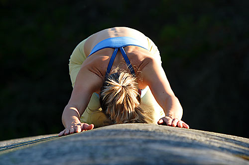 Young woman doing yoga in Squamish, BC, Canada.<br />