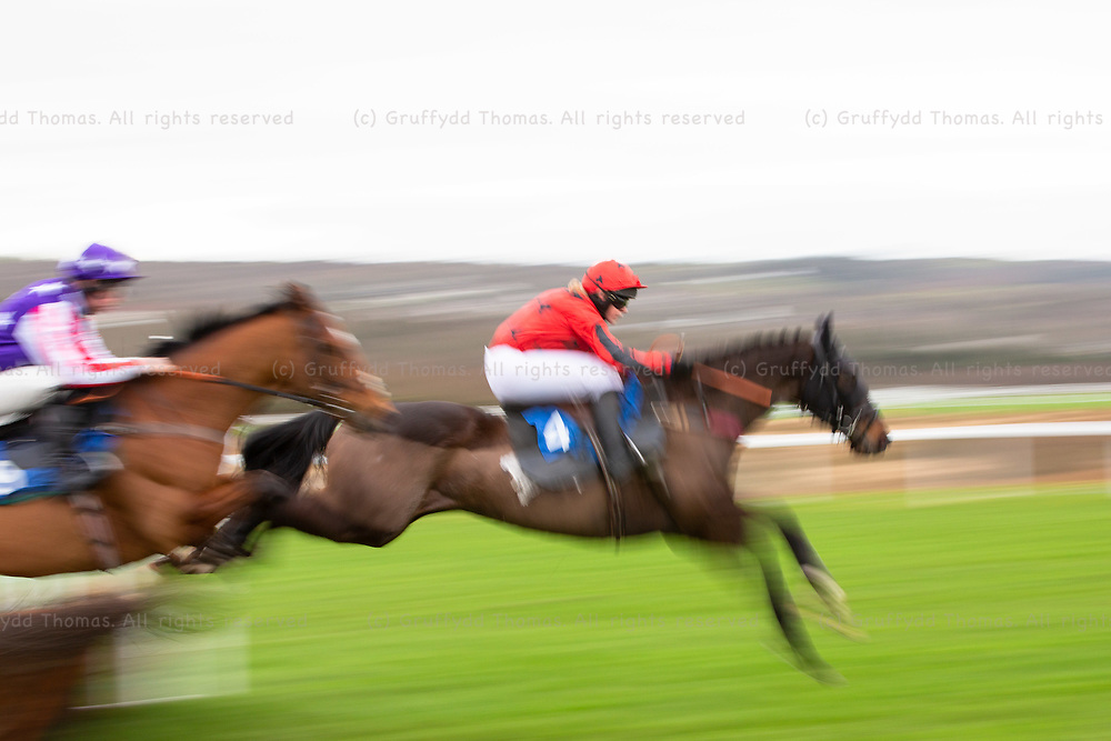 Ffos Las Racecourse, Trimsaran, Wales, UK. Monday 14 January 2019. Khairagash (jockey Lucy Turner) jumps in the Walters Group Novices' Hurdle (Race 2)