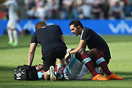 Michail Antonio of West Ham United receives medical treatment after pulling his hamstring. Premier league match, West Ham Utd v Swansea city at the London Stadium, Queen Elizabeth Olympic Park in London on Saturday 8th April 2017.<br /> pic by Steffan Bowen, Andrew Orchard sports photography.