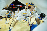 21 MAR 2015: Bryce Alford (20) of University of California - Los Angeles gets his team hyped as the Bruins take on the University of Alabama - Birmingham during the 2015 NCAA Men's Basketball Tournament held at the KFC Yum! Center in Louisville, KY. UCLA defeated UAB 92-75. Brett Wilhelm/NCAA Photos