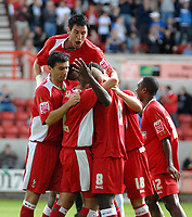 Photo: Ed Godden.<br />Swindon Town v Stockport County. Coca Cola League 2. 26/08/2006. Aaron Brown is swamped by his Swindon team mates after scoring the opening goal.