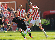 Liverpool's Ben Woodburn  challenges Stoke city's Ryan Shawcross .Premier league match, Stoke City v Liverpool at the Bet365 Stadium in Stoke on Trent, Staffs on Saturday 8th April 2017.<br /> pic by Bradley Collyer, Andrew Orchard sports photography.