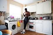 CLONDALKIN, IRELAND - August 13, 2018:  Aidan gets up bright and early to head down to his kitchen for some breakfast cereal.<br /> <br /> Aidan Harris-Igiehon was born in Ireland. Aidan moved to the United States at the age of 12 to pursue his dreams of becoming a professional basketball player. Growing up in Ireland, basketball is not a traditional sport in the country so once Aidan saw some promise and potential he knew that moving to America was his only option. At the age of 12 Aidan had already outgrown his classmates and even dunked his first basketball in middle school. He had to leave his mother in Ireland and went on to live with his Aunt and Uncle in Brooklyn, NY where he would being to start a new life and pursue basketball. <br /> <br /> Aidan had went on to refine his skills and continue to grow - 6'10 240 pounder by the time he was a junior at Lawrence Woodmere Academy in New York. He became a top 50 National prospect and sought after by colleges across the country. This is Aidan's first time seeing his family and friends in 2 years and the first back home since all of the national recognition. Ireland had scheduled a week long of camps and exhibitions that would be featuring Aidan.<br /> <br /> Photo by: Johnnie Izquierdo