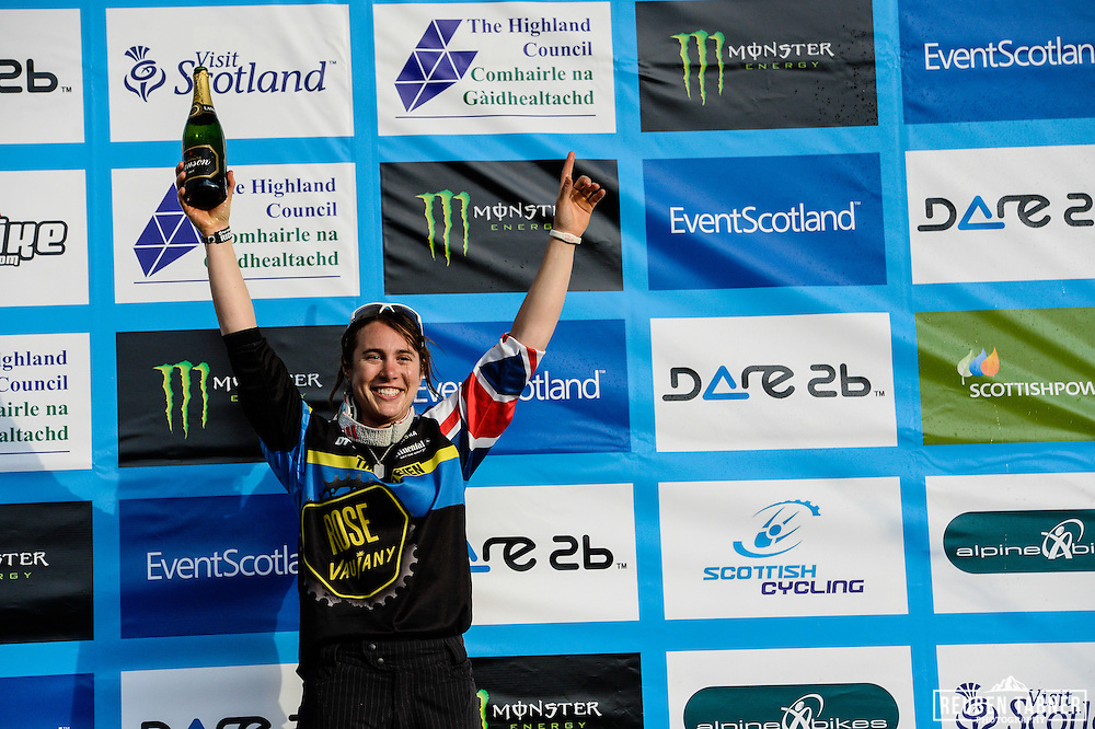 08.06.2013 Fort William, Scotland. Katy Curd of Rose Vaujany Gravity Team celebrates winning the 4X Pro Tour at the UCI Mountain Bike World Cup in Fort William, the First British Female to do so.