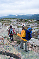 Two young women hiking on Cadillac Mountain in Acadia National Park. Bar Harbor, Maine.<br />