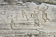 Petroglyph, rock carving, of a group of warriors one  wearing a helmet and carrying a sword and shield. Carved by the ancient Camuni people in the iron age between 1000-1600 BC. Rock no 24,  Foppi di Nadro, Riserva Naturale Incisioni Rupestri di Ceto, Cimbergo e Paspardo, Capo di Ponti, Valcamonica (Val Camonica), Lombardy plain, Italy .<br /> <br /> Visit our PREHISTORY PHOTO COLLECTIONS for more   photos  to download or buy as prints https://funkystock.photoshelter.com/gallery-collection/Prehistoric-Neolithic-Sites-Art-Artefacts-Pictures-Photos/C0000tfxw63zrUT4<br /> If you prefer to buy from our ALAMY PHOTO LIBRARY  Collection visit : https://www.alamy.com/portfolio/paul-williams-funkystock/valcamonica-rock-art.html