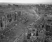 Grozny, Chechnya, March 1995..The Battle of Grozny..Civilians and Russian soldiers in the ruined Chechen captital after rebel forces retreated from the city in the face of the Russian bombardment..A Russian military column makes its way through the ruined city centre..