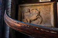 Detail of a gondola and lion plaque at the Museo Storico Navale di Venezia in Venice, Italy