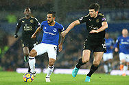 Theo Walcott of Everton (l) is held back by Harry Maguire of Leicester City (r). Premier league match, Everton v Leicester City at Goodison Park in Liverpool, Merseyside on Wednesday 31st January 2018.<br /> pic by Chris Stading, Andrew Orchard sports photography.