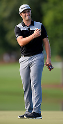 Jon Rahm tries to wave his ball toward the cup on the 16th green during first-round action of the PGA Championship at Quail Hollow Club on Thursday, Aug. 10, 2017, in Charlotte, N.C. (Photo by Jeff Siner/Charlotte Observer/TNS/Sipa USA)  *** Please Use Credit from Credit Field ***
