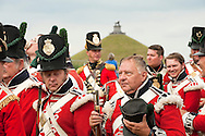 Reenactors on their march to the battle field, with the Butte du Lion monument in the background. Battle of Waterloo 200th reenactment, Belgium (Saturday 20 June 2015). Allied bivuac. © Rudolf Abraham