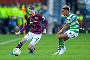Michael Smith (#2) of Heart of Midlothian passes the ball past Scott Sinclair(#11) of Celtic FC during the Betfred League Cup semi-final match between Heart of Midlothian FC and Celtic FC at the BT Murrayfield Stadium, Edinburgh, Scotland on 28 October 2018.