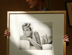 An employee at Christie's auction house holds 'Diana, Princess of Wales' by Mario Testino, 1997, which is expected to fetch £18,000 - £22,000 at Christie's sale of photographs this Friday.