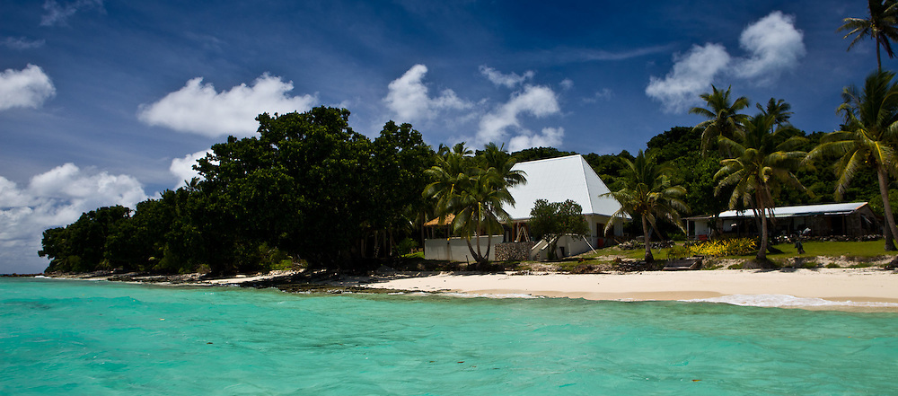 Fiji Shoreline from the Water, with White-Roofed House and Palm Trees