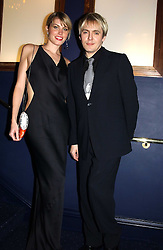 Musician NICK RHODES and MEREDITH OSTROM at a party hosted by Tatler magazine to celebrate the publication of the 2004 Little Black Book held at Tramp, 38 Jermyn Street, London SW1 on 10th November 2004.<br />