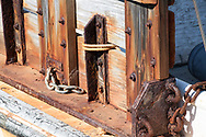"""Tools of the Trade series-<br /> Rusty metal parts lend their color to the weathered wood of this fishing boat. <br /> <br /> For IMAGE LICENSING just click on the """"add to cart"""" button above.<br /> <br /> Fine Art archival paper prints for this image as well as canvas, metal and acrylic prints available here:<br /> http://2-julie-weber.pixels.com/featured/fishing-boat-6-julie-weber.html"""