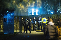© Licensed to London News Pictures. 12/11/2020. Manchester, UK. Police and private security at the University of Manchester's Owens Park campus this evening (12th November 2020) . Students have taken part in a demonstration at the site in support of those who have occupied Owens Park Tower as part of a rent strike at the University . Students object to rent payments for reduced facilities , the University's erection of fencing around the campus and what they describe as the UoM's failure to provide adequate mental health and wider support . Photo credit: Joel Goodman/LNP