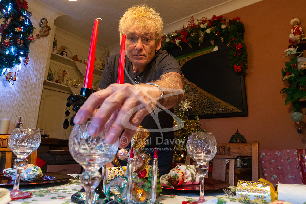 Geoff Stonebanks, 66, sets out the table for in his dining room as he decorates his home in Seaford, East Sussex, with over 3,800 decorations on more than a dozen trees, creating a magical effect that truly celebrates the festive season. Seaford, East Sussex, December 03 2018.