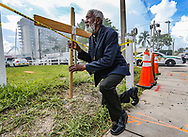 Clayton Harrell stops to pray one block west of the 12-story oceanfront condominium, Champlain Towers South, on Saturday, June 26, 2021. The condo tower partially collapsed early Thursday morning in the town of Surfside.
