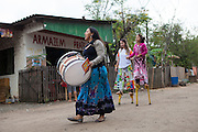 Amanda (centre) and a group of children on their stilts, playing music, singing and reciting poetry in the community near the library, Biblioteca Comunitaria do Arquipelago, Porte Alegre, Brazil. <br /> <br /> Cirandar is working in partnership with  C&A and C&A Instituto to implement a network of Community Libraries in eight communities of Porto Alegre.