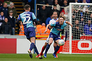 Alex Samuel of Wycombe Wanderers under pressure from Christian Burgess of Portsmouth during the EFL Sky Bet League 1 match between Wycombe Wanderers and Portsmouth at Adams Park, High Wycombe, England on 6 April 2019.