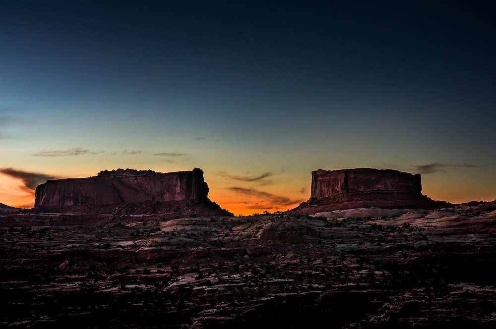 Before the setting sun, the Monitor and Merrimac buttes, named after the civil war battleships of the same name that fought for the Union and Confederate armies, respectively, stand 600 feet above the surrounding Navajo sandstone Arizona landscape.
