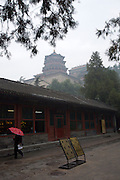 Imperial Summer Palace (Yihe Yuan). Foxiangge (Sea of Wisdom Temple) behind a fast food restaurant.