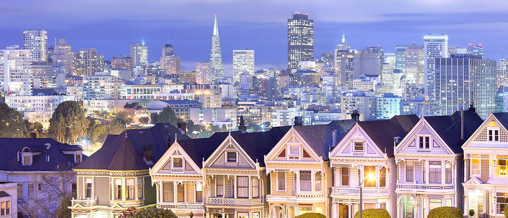 Panoramic skyline of San Francisco from Alamo Square at night, California, United States