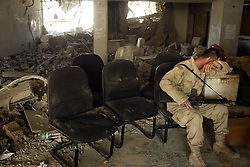 A soldier rests inside the lobby of the Canal Hotel as searching for bodies continues in Baghdad, Iraq on Aug. 21, 2003. Earlier in the week a cement truck packed with explosives detonated outside the offices of the UN headquarters in Baghdad, Iraq, killing 20 people and devastating the facility in an unprecedented suicide attack against the world body. At least 100 people were wounded.