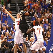University of Central Florida guard Marcus Jordan (5) drives the ball  while taking on the Florida Gators at the Amway Center on December 1, 2010 in Orlando, Florida. Central Florida won the game 57-54 for their first ever victory against a nationally ranked team. (AP Photo/Alex Menendez)
