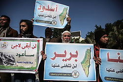 January 30, 2018 - Gaza City, The Gaza Strip, Palestine - Palestinians hold banners and wave flags of Palestine during a march organized by Palestinian factions to mark the International Day of Solidarity with the Palestinian People in Gaza City. (Credit Image: © Hassan Jedi/Quds Net News via ZUMA Wire)