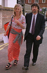 Actress IMOGEN STUBBS and her husband MR TREVOR NUNN, at a party in London on 30th June 1999.MTY 89