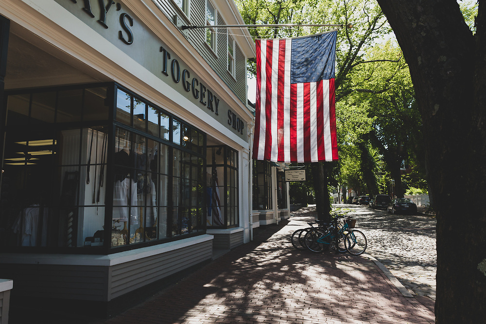 The backlit flag at Murray's shining brightly along Main Street in Nantucket.