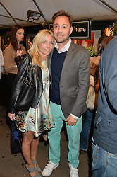 DAN PHILIPSON and VICTORIA McCARTHY at a party to celebrate the launch of the Taylor Morris Eyewear's Summer Collection held at The Chelsea Gardner, 125 Sydney Street, London on 20th May 2015.