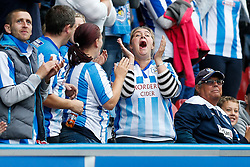 A Huddersfield fan celebrates after her side score - Photo mandatory by-line: Rogan Thomson/JMP - 07966 386802 - 13/09/2014 - SPORT - FOOTBALL - Huddersfield, England - The John Smith's Stadium - Huddersfield town v Middlesbrough - Sky Bet Championship.