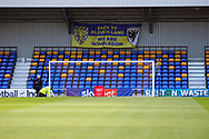 Safe standing seating behind goal and next to a We Are Wimbledon and Back to Plough Lane sign during the EFL Sky Bet League 1 match between AFC Wimbledon and Bristol Rovers at Plough Lane, London, United Kingdom on 5 December 2020.