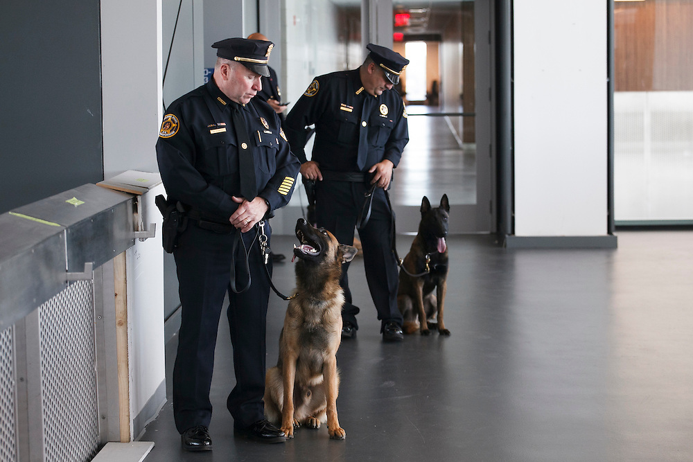 Special Agent Michael O'Keefe of the CSX Police Department with Canine John, honoring Police Officer John D'Allara of ESU Truck 2 who in the September 11, 2001 attacks, before the NYPD Transit Bureau Canine Unit Graduation Ceremony at the College Point Police Academy in Queens, NY on Tuesday, Oct. 6, 2015.<br /> <br /> Andrew Hinderaker for The Wall Street Journal<br /> NYSTANDALONE