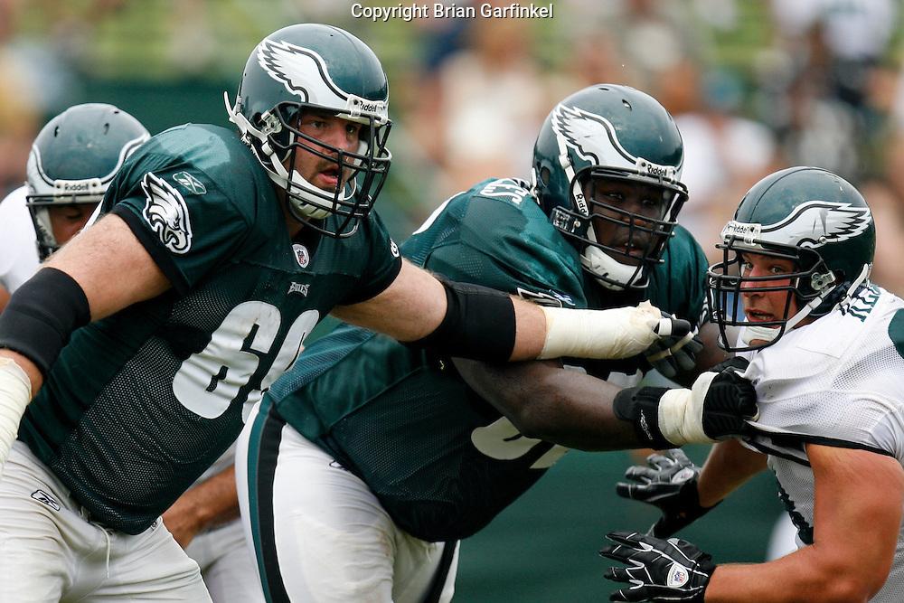 Bethlehem, Pennsylvania - Tackle Jon Runyan and Gaurd Max Jean-Gilles during a play at the Eagles Training camp at Lehigh University.