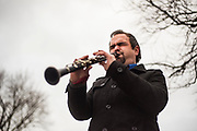 """Daniel Northrup at Gateway Square Center in Clarkston, Washington on Wednesday, Dec. 18, 2019. Northrup worked at Kmart until the store's recent closure and turned to busking to """"do what [he] can"""" for his three kids this holiday season. Northrup has 24 years experience playing music, mainly clarinet and saxophone, and previously spent almost 10 years traveling the country on and off to busk."""