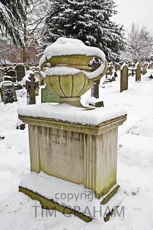 Snow covered monument of Hugh Gaitskell's grave, Hampstead Parish churchyard, London, UK