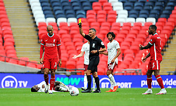 Fabinho of Liverpool is shown a yellow card by referee Andre Marriner - Mandatory by-line: Nizaam Jones/JMP - 29/08/2020 - FOOTBALL - Wembley Stadium - London, England - Arsenal v Liverpool - FA Community Shield