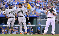 May 29, 2017 - Kansas City, MO, USA - Detroit Tigers' Miguel Cabrera acts surprised next to Kansas City Royals third baseman Mike Moustakas after reaching third on a two-run double by Victor Martinez in the fifth inning on Monday, May 29, 2017 at Kauffman Stadium in Kansas City, Mo. (Credit Image: © John Sleezer/TNS via ZUMA Wire)