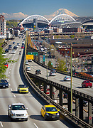 The Alaskan Way Viaduct, completed on April 4, 1953, is a double-decked elevated section of State Route 99 that runs along the Elliott Bay waterfront in the industrial district and downtown of Seattle. It is the smaller of the two major north–south traffic corridors through Seattle (the other being Interstate 5), carrying up to 110,000 vehicles per day. The viaduct runs above the surface street, Alaskan Way, from S. Nevada Street in the south to the entrance of Belltown's Battery Street Tunnel in the north, following previously existing railroad lines.