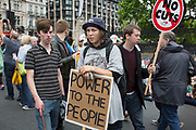 London, UK. Saturday 20th June 2015. People's Assembly against austerity demonstration through Central London. 250,000 people gathered to protest in a march through the capital protesting against the Tory cuts, holding placards and banners. People gathering in Parliamnet Sq for the rally.
