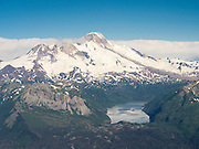Aerial view of the Iliamna Volcano and Hickerson Lake in the foreground. Lake Clark National Park, Alaska.