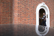Kostica, 42, from Romania, is entering the front door of the Ingram Avenue mansion on Sunday, Sep. 23, 2007, in Hampstead, London, England. The 22-room mansion was last sold for UK£ 3.9M in 2002 and is now awaiting planning permissions to be demolished. Two new houses will soon be taking its place. Million Dollar Squatters is a documentary project in the lives of a peculiar group of squatters residing in three multi-million mansions in one of the classiest residential neighbourhoods of London, Hampstead Garden. The squatters' enthusiasm, their constant efforts to look after what has become their home, their ingenuity and adventurous spirit have all inspired me throughout the days and nights spent at their side. Between the fantasy world of exclusive Britain and the reality of squatting in London, I have been a witness to their unique story. While more than 100.000 properties in London still lay empty to this day, squatting provides a valid, and lawful alternative to paying Europe's most expensive rent prices, as well as offering the challenge of an adventurous lifestyle in the capital.