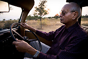 Rawat Nahar Singhji, also known as Rao Saheb, drives his old american Jeep across his land close to his Fortress Deogarh Mahal, now a heritage hotel, Udaipur, Rajasthan, India.
