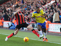 Bournemouth captain Tommy Elphick intercepts Huddersfield Town's Ishmael Miller - Photo mandatory by-line: Paul Knight/JMP - Mobile: 07966 386802 - 14/02/2015 - SPORT - Football - Bournemouth - Goldsands Stadium - AFC Bournemouth v Huddersfield Town - Sky Bet Championship